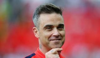 Robbie Williams: «Έστειλα ένα από τα βραβεία μουσικής που έχω κερδίσει στον… Wayne Rooney»